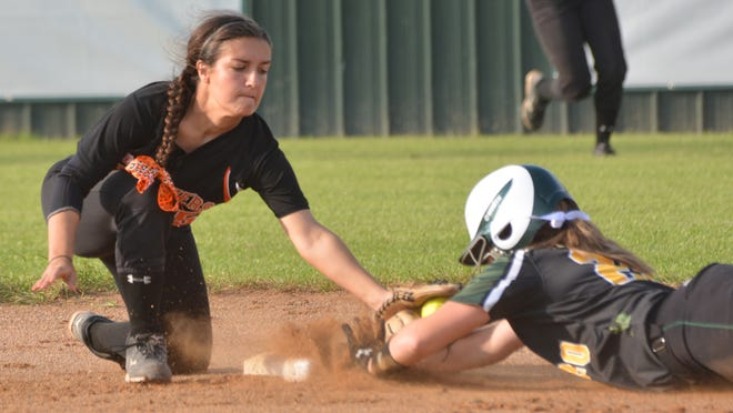 Jensen Howell (20, right) gets to second ahead of the Delcambre's Taylor Broussard's tag Thursday.