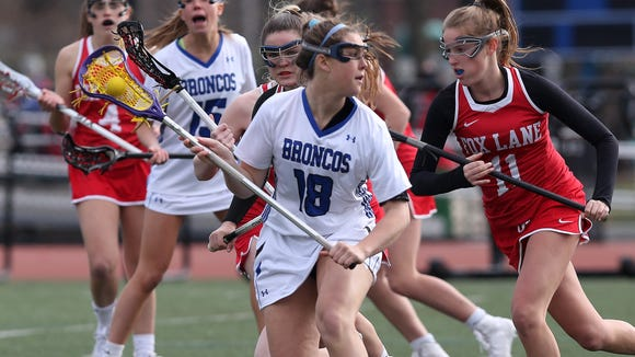 Bronxville's Allie Berkery (18) drives to the goal