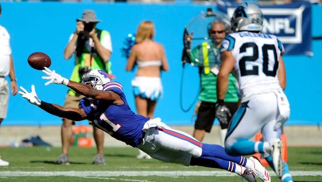 Buffalo Bills' Zay Jones (11) misses a catch on fourth down as Carolina Panthers' Kurt Coleman (20) defends late in the second half of an NFL football game in Charlotte, N.C., Sunday, Sept. 17, 2017. (AP Photo/Mike McCarn)