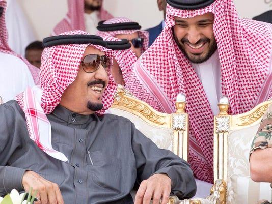 Saudi king swears in new ministers