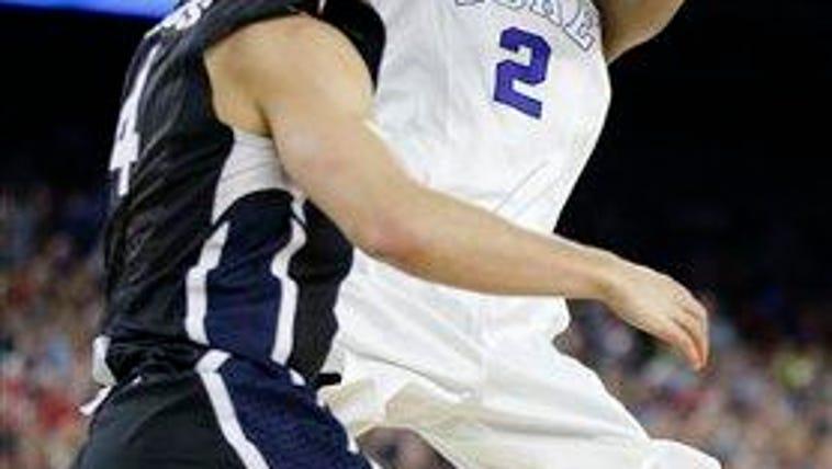 Duke's Quinn Cook (2) shoots over Gonzaga's Kevin Pangos