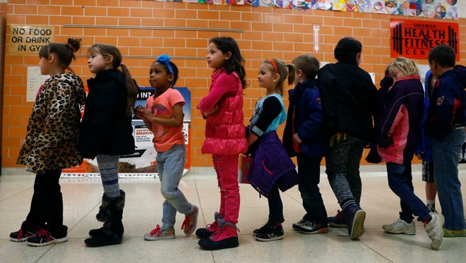 Students wait for lunch to begin at Sherman Elementary on  March 24.