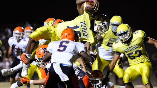 Hillsboro's Darius Smith (15) dives in to score a touchdown against Beech during the second half at Hillsboro High School, Friday, Oct. 28, 2016, in Nashville, Tenn.