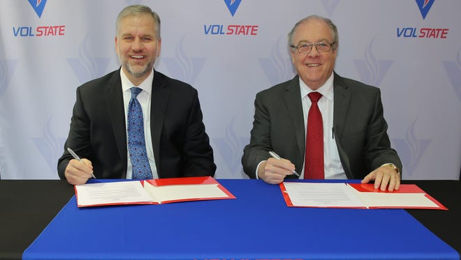 Welch College president, J. Matthew Pinson and Vol State president, Jerry Faulkner, sign the transfer agreement in Gallatin.