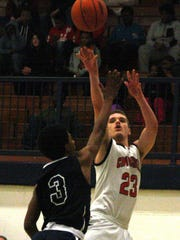 Churchill's Joan Andoni releases a long three-point shot over Thurston's Eric Bonner.