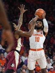 Clemson guard Gabe DeVoe (10) shoots against Florida