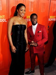 """Tiffany Haddish and Kevin Hart pose together at the """"Night School"""" premiere."""