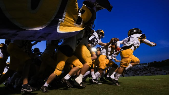 Prince Avenue players take the field prior to a GHSA high school football game between Wesleyan and Prince Avenue Christian in Norcross, Ga., on Friday, Oct. 2, 2020.
