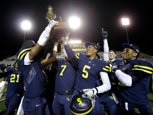 Lausanne Collegiate players celebrate after defeating