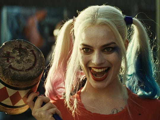"""SS-T2-0100Film Name: SUICIDE SQUADCopyright: © 2016 WARNER BROS. ENTERTAINMENT INC. AND RATPAC-DUNE ENTERTAINMENT LLCPhoto Credit: Courtesy of Warner Bros. Pictures/ TM & © DC ComicsCaption: (L-r) MARGOT ROBBIE as Harley Quinn in Warner Bros. Pictures' action adventure """"SUICIDE SQUAD,"""" a Warner Bros. Pictures release."""