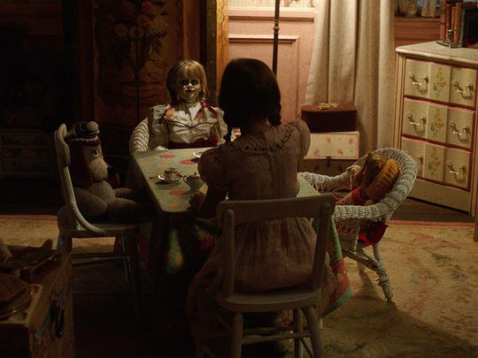 "The Annabelle doll invites you to tea in ""Annabelle: Creation."""