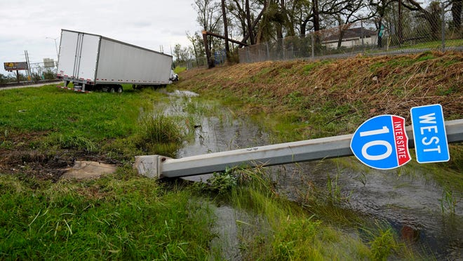 A truck and Interstate 10 sign is seen on Thursday, Aug. 27, 2020, in Lake Charles, La., after Hurricane Laura moved through the state.