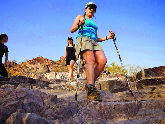 Terry Wilner (front) of Michigan and daughter Julie (rear) of San Francisco hike down the Piestewa Peak Summit Trail in Phoenix