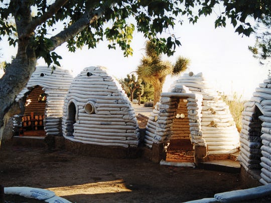 "This 1995 photo provided by MoMA shows a group of Sandbag Shelters. The photograph is featured in the exhibit ""Insecurities: Tracing Displacement and Shelter,"" at the museum in New York. The new exhibit invites visitors to take an entirely new look at the concept of home and design, this time through the lens of migration and global refugee emergencies, in which temporary shelters, organizers say, are being deployed on a scale akin to that after World War I."