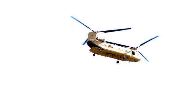 Frank Galipo, a freelance photographer for the Asbury Park Press, snapped this photo of the Boeing CH-47 Chinook as it flew west at low altitude over Barnegat Bay near the Ortley Beach section of Toms River on Sunday.