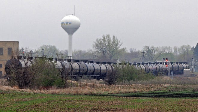 A line of oil tanker cars sit on the BNSF railroad tracks in Harvey, N.D.