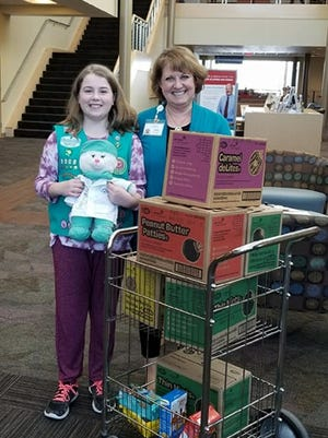 Katelyn Hoelzel, a Kaukauna fifth grade Girl Scout, is pictured with Jean Monson, volunteer and facilities coordinator for Fox Valley Hematology & Oncology. Katelyn donated the cookies she sold to people throughout the Fox Valley to FVHO in Appleton.