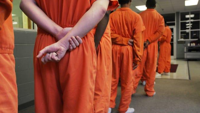 Residents stand in line for breakfast at a juvenile detention center in Shreveport, La.