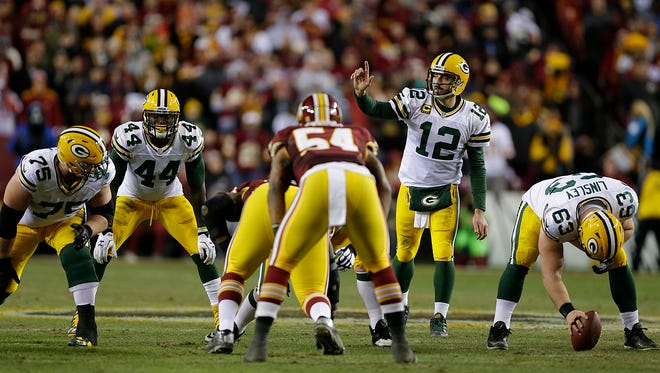 Green Bay Packers quarterback Aaron Rodgers (12) against Washington Redskins during Sunday's NFC wild-card round playoff game at FedEx Field.