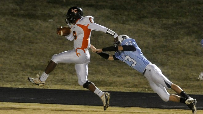 FILE – Camion Patrick (6) scores a touchdown for Lenoir City during his prep days in Tennessee.