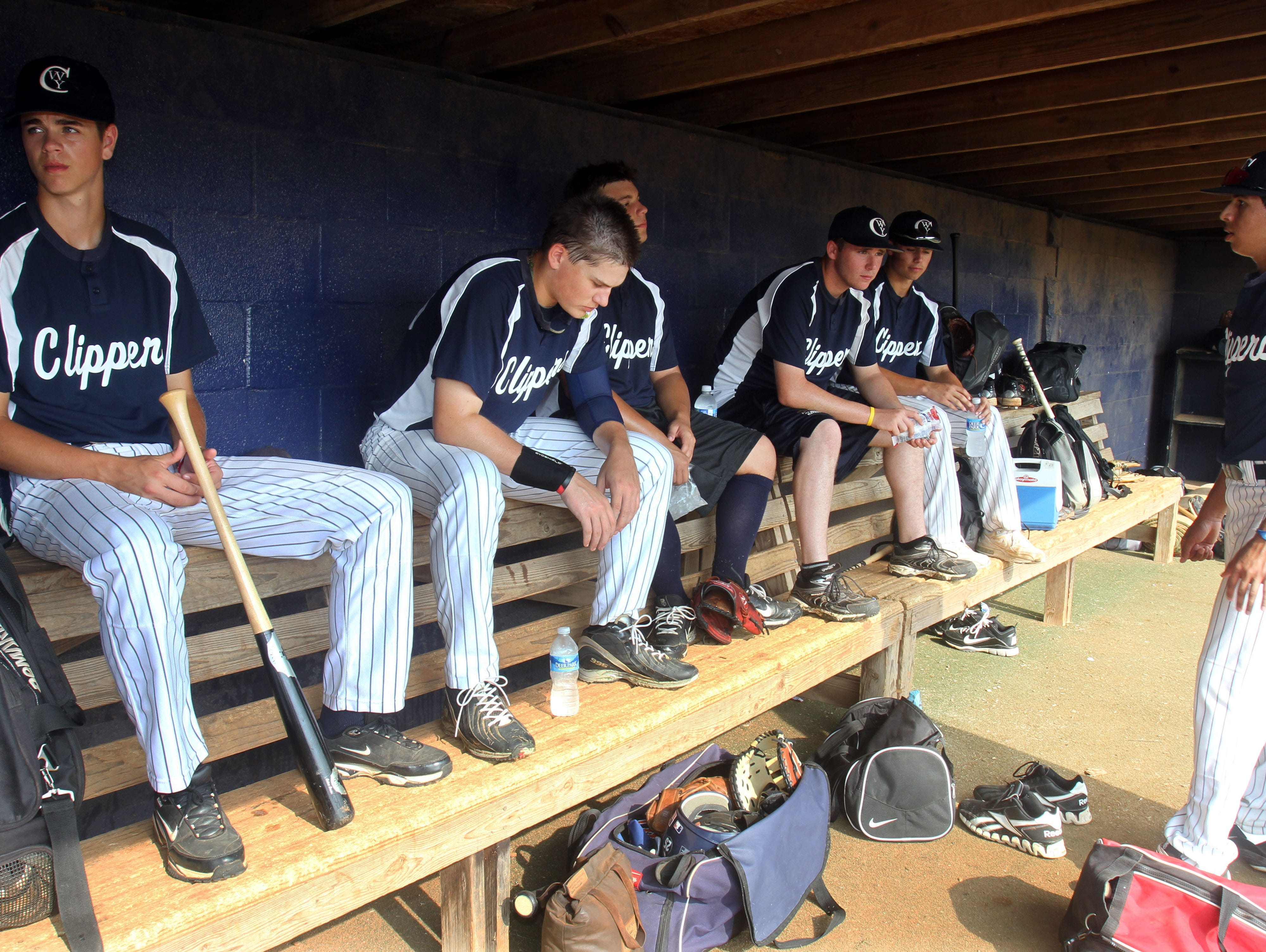 Members of the World Yacht Clippers, which is comprised of high school baseball players primarily from Lower Hudson region, sit in the dugout before a game during the Perfect Game Invitational Baseball Tournament in Marietta, Ga. July 12, 2011. Thousands of the best high school baseball players in the nation gathered for two weeks to play games in front of college and professional scouts in the hope of receiving scholarships to colleges or being pursued major league organizations. ( Seth Harrison / The Journal News )