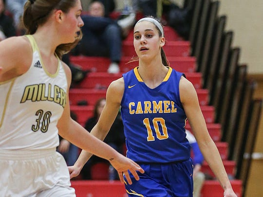 Noblesville Millers Emily Kiser (30) guards Carmel Greyhounds guard Amy Dilk (10) during semifinals action between the Carmel Greyhounds and Noblesville Millers at Fishers High School in Fishers, Ind., Friday, Feb. 2, 2018. Carmel won, 50-45.