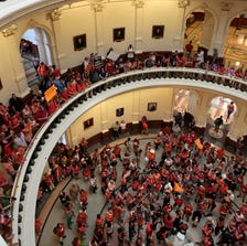 AUSTIN, TX - JULY 01: Pro-choice and pro-life supporters fill the Texas State capitol rotunda on July 1, 2013 in Austin, Texas.  (Photo by Erich Schlegel/Getty Images)