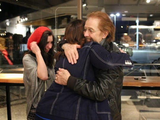 Ted Neeley gives a hug to one of his fans, Bridget