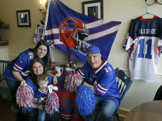 Die-hard Bills fan Pierre Heroux, right, poses with