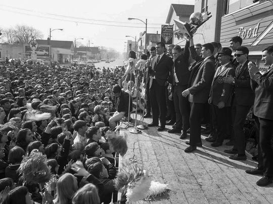 The 1967-68 Manitowoc boys basketball team celebrates its WIAA state championship victory during a rally at the Mikadow Theater in Manitowoc. An estimated 5,000 showed up.