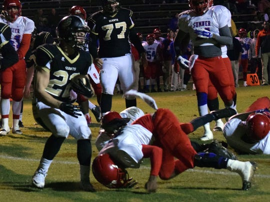 Jena's Jordan Mitchell (22, left) gets into the end zone ahead of Sumner defenders Friday.