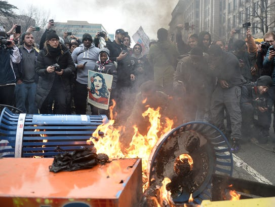 Protesters set fire to trash cans on President Trump's