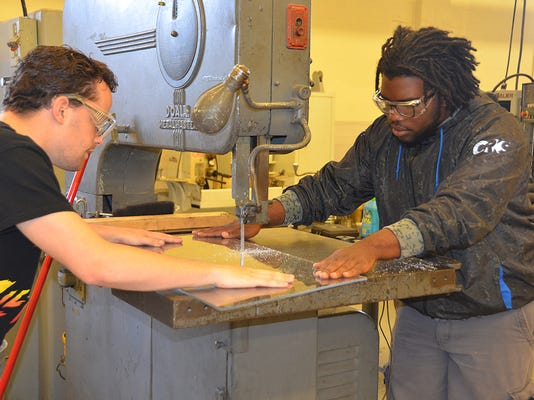 FirstSTEP students cut plexiglass.jpg