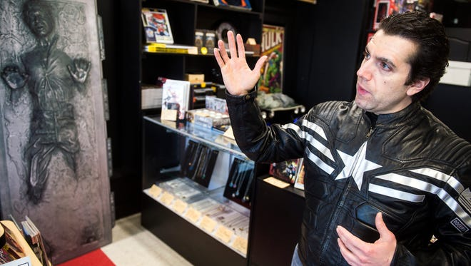Matthew Madrigale, owner of Kirby Comics on York Street, stands in front of his store while explaining the reason behind naming the store after Jack Kirby, Tuesday, Jan. 9, 2018. Kirby Comics, on York Street, is Hanover's newest comic book store. It opened in December, 2017.