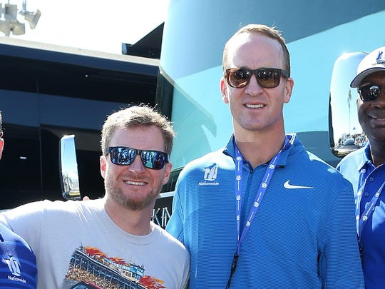 DAYTONA BEACH, FL - FEBRUARY 18:  Two-time Super Bowl winning quarterback and honorary pace car driver, Peyton Manning and his son, Marshall, pose with former NASCAR driver Dale Earnhardt Jr. prior to the Monster Energy NASCAR Cup Series 60th Annual Daytona 500 at Daytona International Speedway on February 18, 2018 in Daytona Beach, Florida.  (Photo by Brian Lawdermilk/Getty Images) ORG XMIT: 775122451 ORIG FILE ID: 919955784