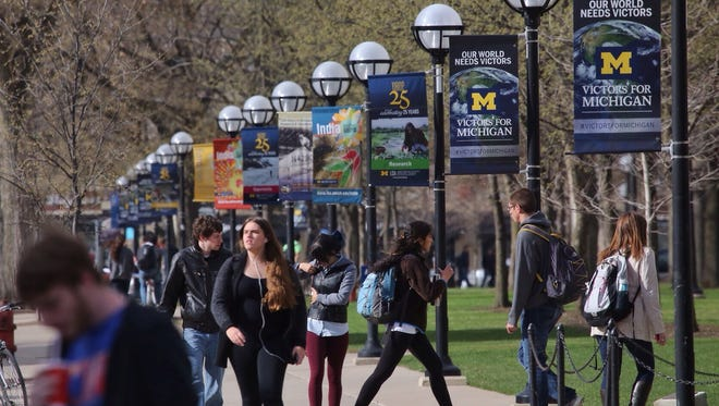Students walk along South State Street through the Ann Arbor campus of the University of Michigan in this 2014 file photo.