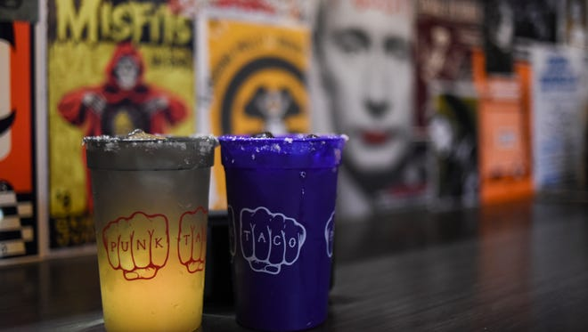 Homemade margaritas are $6, and are served in hyper color cups that you can take home.