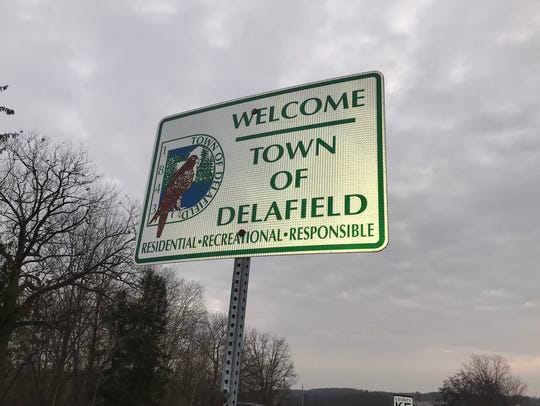Road signs along the borders of the town of Delafield