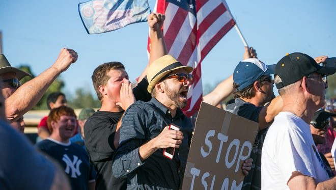 Anti-Islam protesters gather outside a mosque in Phoenix on Friday, May 29, 2015.