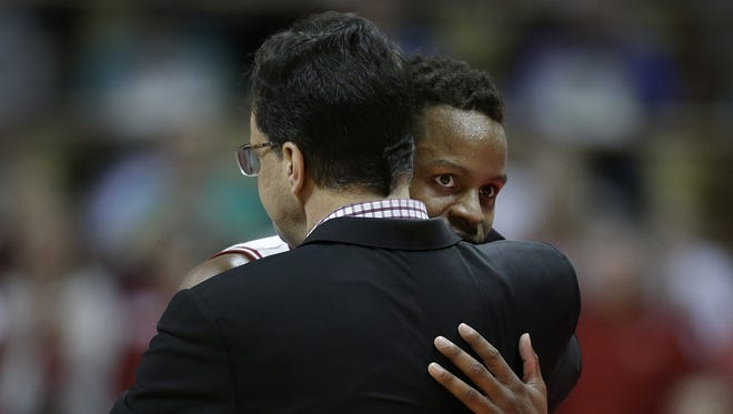 Indiana Hoosiers guard Yogi Ferrell (11) hugs head coach Tom Crean as he leaves the game late in the second half of their B1G men's basketball game Sunday, Mar 6, 2016, afternoon at Assembly Hall in Bloomington.
