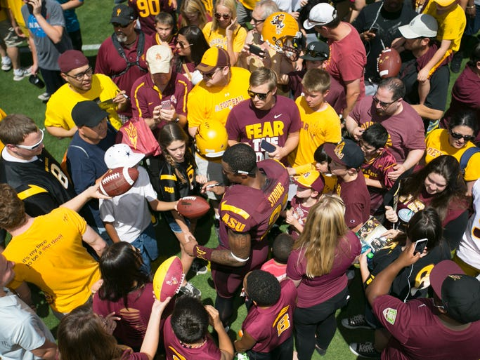 ASU wide receiver Jaelen Strong signs autographs for fans following the ASU football spring game at Sun Devil Stadium in Tempe on Saturday, April 19, 2014.