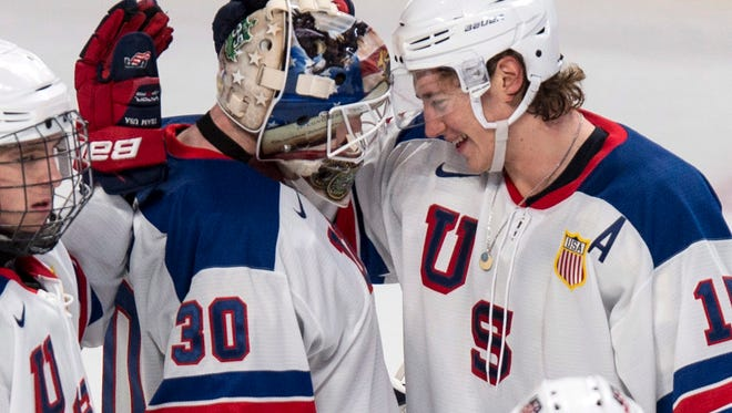 Team USA's John Hayden congratulates goaltender Thatcher Demko after shutting out Team Slovakia 3-0 during preliminary round hockey action at the IIHF World Junior Championship, Monday, Dec. 29, 2014 in Montreal.