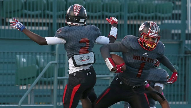 Wilson's Desi Floyd Jr. right, leaps up in celebration with teammate Rickey Gamble Jr., after scoring in the first quarter of a Section V playoff game last fall. Wilson won the Class A title.
