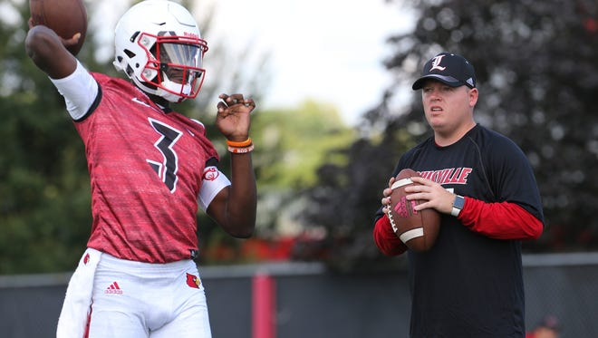 U of L QB Coach Nick Petrino observed the technique of QB Malik Cunningham (3) during practice.