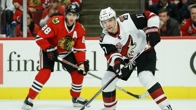Arizona Coyotes right wing Radim Vrbata, right, looks to pass the puck away from Chicago Blackhawks right wing Patrick Kane, left, during the first period, Tuesday, Dec. 6, 2016, in Chicago.