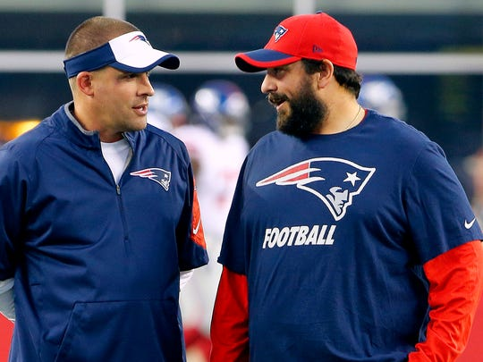 Patriots offensive coordinator Josh McDaniels, left, talks with defensive coordinator Matt Patricia before a game against the Giants in Foxborough, Mass. on Sept. 3, 2015.