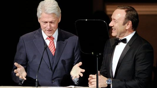 Former President Bill Clinton and actor Kevin Spacey on stage together at the 25th Anniversary Rainforest Fund benefit concert at Carnegie Hall on Thursday, April 17, 2014 in New York.