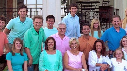 In this 2006 photo provided by Hobby Lobby are members of the Green family that run the Oklahoma-based arts and craft chain, from left, front: Amy Green Fallon; Diana Green; Barbara Green; Darsee Lett; Grace Green and Jackie Green: middle row, from left: Tyler Green; Mart Green; David Green; Stan Lett and Steve Green: back row, from left: Brent Green; Scott Green; Derek Green; Danielle Green and Lindy Green at David and Barbara's home near Oklahoma City. The U.S. Supreme court ruled 5-4 Monday, June 30, 2014 that requiring closely-held companies such as Hobby Lobby to pay for methods of women's contraception to which they object violates the corporations' religious freedom.