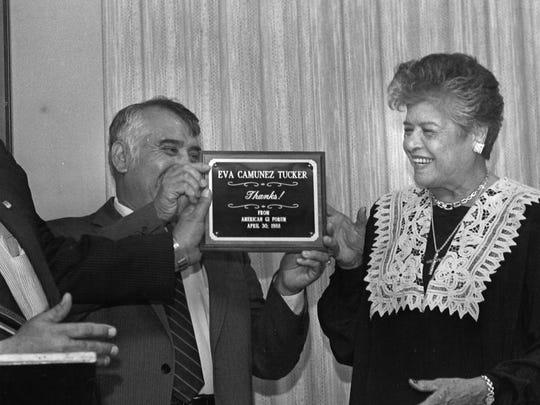 Eva Camunez Tucker receiving a plaque of appreciation from the American GI Forum in 1988.