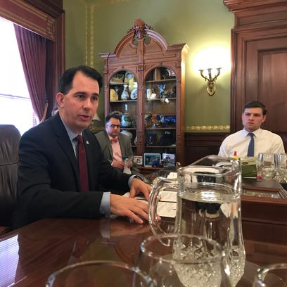 Wisconsin Gov. Scott Walker wants $200 million to strengthen Obamacare and hold down premiums